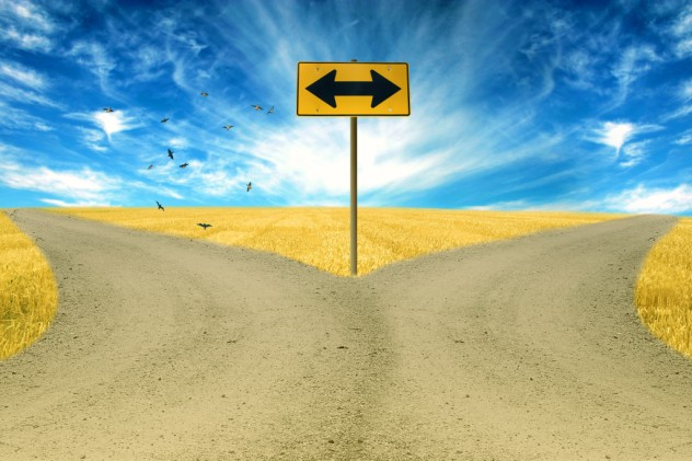 two roads, road sign ahead with arrows blue sky background